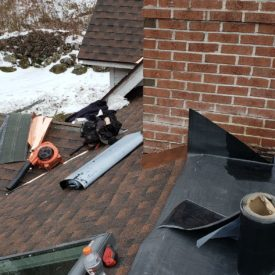 Shingle Roofing With Chimney And Skylight And Flat Roof