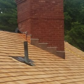 Wood Shake With Copper Flashing Chimney
